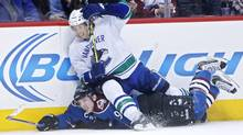 ancouver Canucks left wing David Booth falls on Colorado Avalanche centre Matt Duchene as they battle for the puck during the second period at Pepsi Center. (USA TODAY Sports)