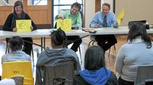 (L-R) Winnipeg North NDP candidate Rebecca Blaikie, Green Party candidate John Harvie, and Liberal candidate Kevin Lameroux answer 'YES' to a question during an event organized by North End Votes and its member organizations in which politicians met and answered questions asked by Aboriginal youth at Thunderbird House in Winnipeg Thursday April 21, 2011. (David Lipnowski for The Globe And Mail/David Lipnowski for The Globe And Mail)