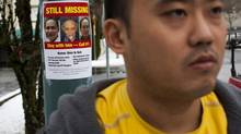 Sam Noh, son of Shin Ik Noh who went missing from Coquitlam in September, is photographed near a missing person poster of his father in Port Moody, British Columbia, Wednesday, December 11, 2013. Sam is advocating for a silver alert, that would be like amber alerts for kids. (Rafal Gerszak for the Globe and Mail)