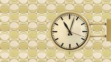 Seventies vintage office clock against a retro wallpaper backgro (DutchScenery/Getty Images/iStockphoto)