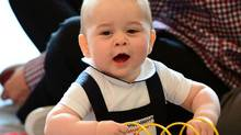 Britain's Prince George plays with a toy at a Plunket play group event at Government House in Wellington, April 9, 2014. Britain's Prince William and his wife Kate are undertaking a 19-day official visit to New Zealand and Australia with their son George. (REUTERS)