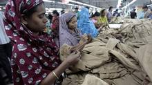 Women work at a garment factory in Savar, Bangladesh, earning about $37.50 per month. (ANDREW BIRAJ/REUTERS)
