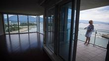 Realtor Holly Wood stands on the balcony of a condo that the owner has decided to rent out, in Vancouver on Sunday. (DARRYL DYCK/THE GLOBE AND MAIL)
