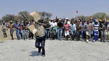 Striking mineworkers take part in a demonstration in Rustenburg, South Africa, Saturday Oct. 6 2012. (AP)