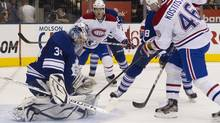 Toronto Maple Leafs goaltender James Reimer (left) saves as shot from Montreal Canadiens' Andrei Kostitsyn (right) during first period NHL hockey action in Toronto on Thursday October 6, 2011. (Chris Young/THE CANADIAN PRESS)