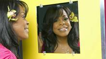 Niecy Nash admires her reflection. (Robert Ector / TLC)
