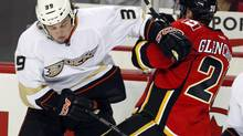 Anaheim Ducks' Matt Beleskey, left, checks Calgary Flames' Curtis Glencross during second period NHL hockey action in Calgary, Alta., Monday, Jan. 21, 2013. (Jeff McIntosh/THE CANADIAN PRESS)