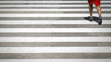 A pedestrian crossing in Vancouver May 24, 2012. (John Lehmann/The Globe and Mail/John Lehmann/The Globe and Mail)