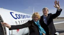 Conservative Leader Stephen Harper and his wife Laureen wave upon arrival in Val D'Or, Que., on April 19, 2011. (Frank Gunn/THE CANADIAN PRESS)