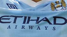 The corporate logo of Etihad Airways as seen on a Manchester City jersey. The NBA is currently considering adding corporate logos to its jerseys. REUTERS/Andrew Winning (Andrew Winning/Reuters)