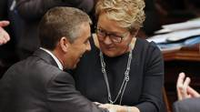 Quebec's Minister of Finance Nicolas Marceau (L) shakes the hand of Quebec's Premier Pauline Marois after presenting his provincial budget at the National Assembly in Quebec City, February 20, 2014. (MATHIEU BELANGER/REUTERS)