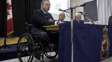 From left, Major Mark Campbell (retired), J. Gerald Lenoski, VP and director of Equitas, and Donald Sorochan, Q.C., partner at Miller Thompson LLP, speak during a meeting to discus a lawsuit brought on by six injured veterans, including Campbell, and how the Canadian government is failing veterans, at the Royal Canadian Legion Branch 617 in Toronto on Thursday, June 5, 2014. (Matthew Sherwood for The Globe and Mail)
