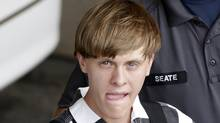 In this June 18, 2015, file photo, Charleston, S.C., Dylann Roof is escorted from the Cleveland County Courthouse in Shelby, N.C. (Chuck Burton/AP)