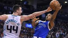 Toronto Raptors guard Kyle Lowry (7) takes a shot as Charlotte Hornets center Frank Kaminsky (44) defends in the fourth quarter at the Air Canada Centre in Toronto, on Feb. 15, 2017. (Dan Hamilton/USA Today Sports)