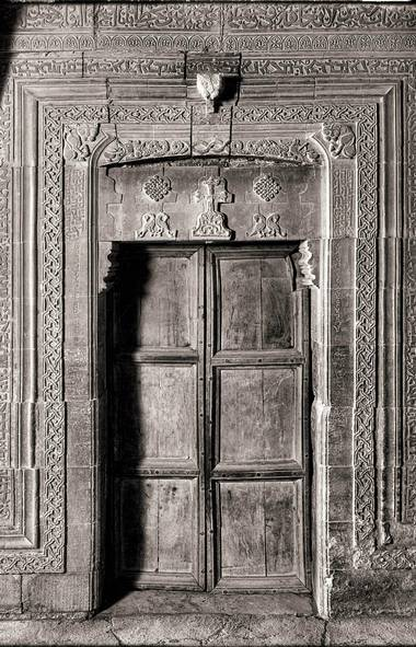 Mār Behnam (doorway) - Martyrion of Mār Behnam, c. 13th century. The Martyrion of Mār Behnam contains a trilingual inscription: Syriac, Arabic, and Uyghur (Old Turkic). Uyghur was used by the Mongols. This is the only known example of a Uyghur inscription in Iraq. It relates to a donation given to Mār Behnam by a Mongol Khan c. 1300 A.D. The monastery had been earlier ransacked by the Mongols; the donation was restitution. The b/w image was taken in the 1930's; the original was from a glass plate negative.