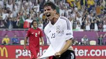 Germany's Mario Gomez celebrates his goal against Portugal during their Group B Euro 2012 soccer match in Lviv, June 9, 2012 (Reuters)