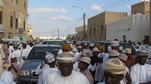 A crowded street in Taqah, Oman. In Oman, around 1.3 million of the population of about 3.3 million are foreigners, most of them workers brought in to do jobs in the oil, construction and services industries. (Tanaz Bhathena For The Globe and Mail)