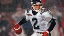 Toronto Argonauts quarterback Doug Flutie scrambles with the ball during first half action against the Edmonton Eskimos at the Grey Cup in Hamilton, Ont. Sunday, Nov. 24, 1996. (FRANK GUNN/THE CANADIAN PRESS)