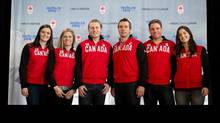 Ski-cross athletes, from left to right, Marielle Thompson, of Whistler, B.C., Georgia Simmerling, of West Vancouver, B.C., Brady Leman, of Calgary, Alta., Dave Duncan, of London, Ont., Chris Del Bosco, of Montreal, Que., and Kelsey Serwa, of Kelowna, B.C., stand together for a photograph after being named to the Sochi 2014 Canadian Olympic team in Vancouver, B.C., on Monday January 27, 2014. THE CANADIAN PRESS/Darryl Dyck (DARRYL DYCK/THE CANADIAN PRESS)
