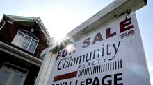A for sale sign sits in front of a Mississauga residential home, April 16, 2012. (J.P. MOCZULSKI For The Globe and Mail)