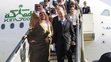 Chairman of Kingdom Holding Company Prince al-Waleed bin Talal (front, L) walks down the steps from his A380 superjumbo beside Airbus President and Chief Executive Tom Enders in Dubai November 12, 2007. Prince al-Waleed is disputing how Forbes puts together its list of the world's richest people. (AZIZ SHAH/REUTERS)