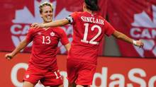 Canada midfielder Sophie Schmidt celebrates with Canada forward Christine Sinclair after she scored against Germany goalkeeper Nadine Angerer (not pictured) during the second half in a women's soccer friendly at BC Place in Vancouver on June 18. (Anne-Marie Sorvin/USA Today Sports)