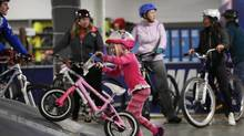 Ruby Andrews, 4, pushes her bike up a ramp at Joyride 150 in Markham, Ontario on Saturday, January 31, 2015. Ontario Premier Kathleen Wynne announced on March 8, 2016 that sports organizations hoping for provincial funding will have to place greater emphasis on including women and girls. (Peter Power For The Globe and Mail)