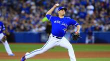 Blue Jays' Roberto Osuna throws a pitch in the ninth inning against the Baltimore Orioles during the American League Wild Card game at Rogers Centre on October 4, 2016 in Toronto. (Vaughn Ridley/Getty Images)
