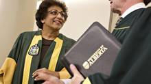 Indira Samarasekera, president of the University of Alberta, chats with a participant in a convocation ceremony in Edmonton on November 21, 2012. Alberta slashed university operating grants 6.8 per cent just one year after promising more money, which amounted to a $40-million blow to the University of Alberta. (Jason Franson for The Globe and Mail)