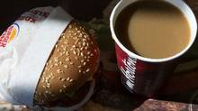 A cup of Tim Hortons coffee is pictured Burger King Whopper at a Burger King restaurant in Toronto on Monday August 25, 2014. (Chris Young for The Globe and Mail)
