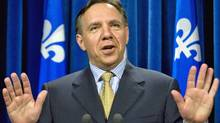 Parti Quebecois finance critic Francois Legault announces his resignation on June 25, 2009 at the Quebec National Assembly. (Jacques Boissinot/THE CANADIAN PRESS)