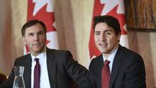 Prime Minister Justin Trudeau and Finance Minister Bill Morneau, Minister of Finance meet with members of the banking and finance community during a meeting in Toronto on Monday morning. (Fred Lum/The Globe and Mail)