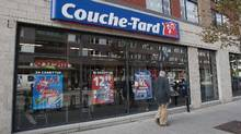 File photo of a man passing a Couche-Tard convenience store in Montreal. (Graham Hughes/The Canadian Press)
