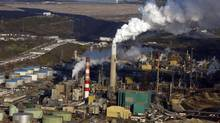 A Suncor oil sands facility near Fort McMurray, Alta. Companies will find it increasingly difficult to justify expansion of high-cost oil sands projects, CIBC says in a new report. (Jeff McIntosh/THE CANADIAN PRESS)