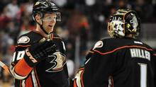 Anaheim Ducks right wing Corey Perry (10) celebrates the 1-0 victory with goalie Jonas Hiller (1) against the Detroit Red Wings following the third period at Honda Center. (USA TODAY Sports)