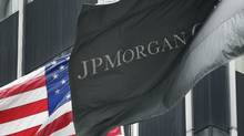 The corporate flag for JPMorgan Chase flies at corporate headquarters, Monday, May 14, 2012 in New York. (Mark Lennihan/Mark Lennihan/AP)
