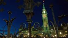 Parliament Hill is illuminated at dusk on Nov. 17, 2011. (Sean Kilpatrick/Sean Kilpatrick/The Canadian Press)