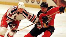 Florida Panthers' defensman Paul Laus (R) fights for control of the puck with New York Rangers' center Wayne Gretzky (99) during action in the third period of their NHL playoff game, April 23 at New York's Madison Square Garden. (Jeff Christensen/REUTERS)