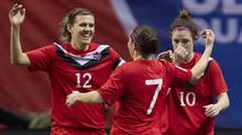 Canada's Christine Sinclair (12) celebrates her goal over Haiti with teammates Rhian Wilkinson (7) and Christina Julien (10) during the first half of CONCACAF Women's Olympic qualifying soccer at B.C. Place in Vancouver, B.C., Thursday, Jan. 19, 2012. (JONATHAN HAYWARD/THE CANADIAN PRESS)