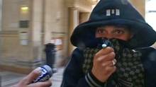A man identified by a lawyer as Cherif Kouachi, one of the two brothers implicated in the who killed 12 people in the attack on the weekly paper Charlie Hebdo attack in Paris, is seen in this still image outside a Paris courthouse while facing charges of helping smuggle Islamist fighters into Iraq, in March 19, 2008. (<137>REUTERS TV<137><137><252><137>/REUTERS TV)