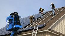 A crew installs solar panels on a house in Ontario. Natural Resources Minister Joe Oliver said Monday that the solar sector cannot expect any increase in support from Ottawa until the deficit is tamed. (Pure Energies/Pure Energies)