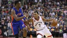 Toronto Raptors point guard Kyle Lowry (7) goes up against Detroit Pistons point guard Reggie Jackson (1) at the Air Canada Centre in Toronto on Saturday, Jan. 30, 2016. The Raptors beat the Pistons 111-107. (Tom Szczerbowski/USA Today Sports)