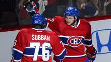 Montreal Canadiens' Alex Galchenyuk, right, celebrates with teammate P.K. Subban after scoring on New York Rangers goalie Henrik Lundqvist during first period in game five of the NHL Eastern Conference final Stanley Cup playoff action Tuesday, May 27, 2014 in Montreal. (The Canadian Press)