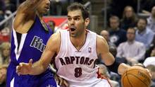 Toronto Raptors' Jose Calderon (R) drives to the basket past Sacramento Kings' Isaiah Thomas in the second half of their NBA basketball game in Toronto January 11, 2012. (FRED THORNHILL/REUTERS)