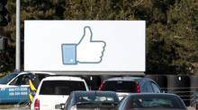 Cars are shown driving past a sign at Facebook headquarters in Menlo Park, Calif., Thursday, Feb. 23, 2012. Mr. Taylor said Facebook would lend its weight to a push for better web standards that enable more apps to be delivered via a simple Internet browser, instead of going through Apple and Google's stores. (Jeff Chiu/Jeff Chiu/AP)