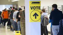 Several dozen voters wait in a half-hour long lineup at the advance polling station at OCAD in downtown Toronto, Ont. on Monday October 12, 2015. (J.P. MOCZULSKI/J.P. MOCZULSKI)