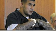Former New England Patriots football tight end Aaron Hernandez stands during a bail hearing in Fall River Superior Court in this June 27, 2013 file photo taken in Fall River, Mass. (Ted Fitzgerald/AP)
