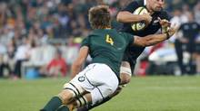 South Africa's Eben Etzebeth (L) tackles New Zealand's Liam Messam during their Rugby Championship union test match in Soweto October 6, 2012. (MIKE HUTCHINGS/REUTERS)