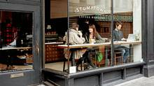 People enjoy a sip at the Stumptown coffee shop in Portland, Ore.