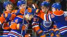 The Edmonton Oilers congratulate Taylor Hall (4) on his penalty shot goal against the Tampa Bay Lightning during second period NHL hockey action in Edmonton, Alta., on Monday October 20, 2014.